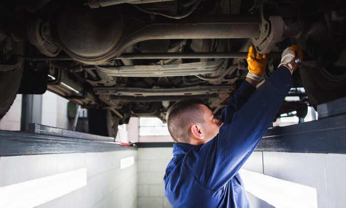 Suspension system of SUV restoration in garage