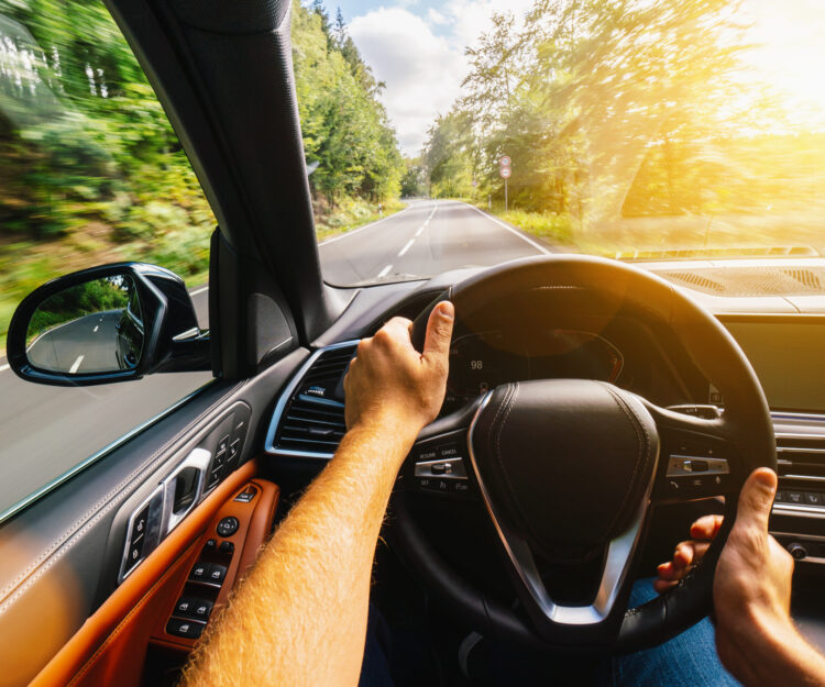 hands of car driver on steering wheel, Driving car at summer day on a country road, having fun driving the empty highway on tour journey – POV, first person view shot